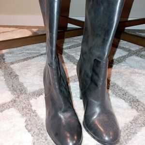 Black high heeled all leather boots